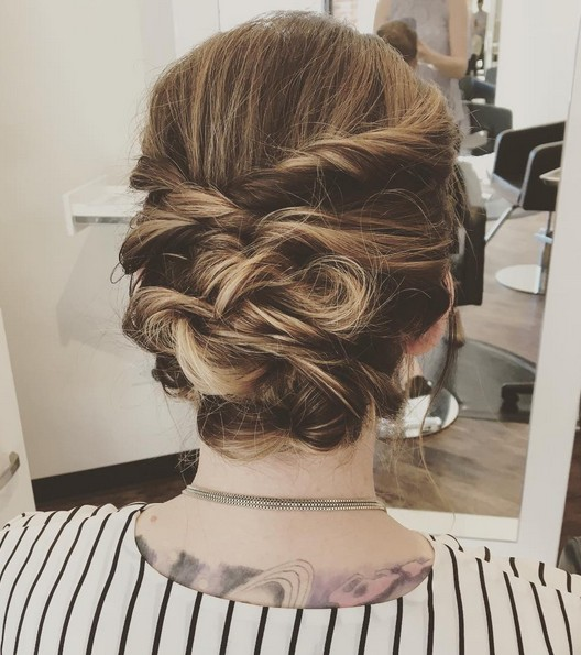 Messy updo using twists and topsy tails combined!