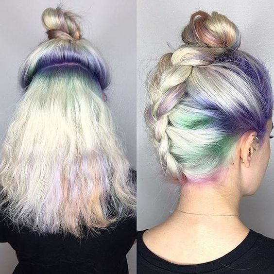 Cute alternative bun. I've never been able to manage the upside-down french braid bun, but this seems to be an easier method (though with a Dutch braid rather than French braid).: