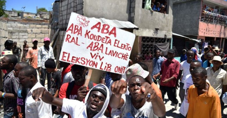 Supporters of opposition political parties march in Port au Prince on September 9