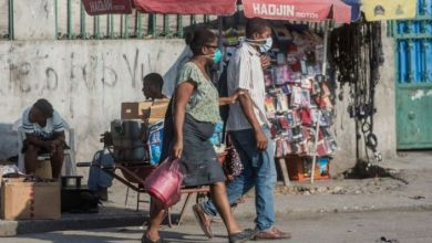 Two people in the Haitian capital Port au Prince wear face masks credit AFP Pierre Michel Jean