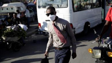 man masked credit America Magazine