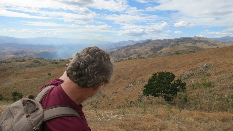 Dixon's hair seemed to follow the same pattern as the grasses upon the Haitian hillsides