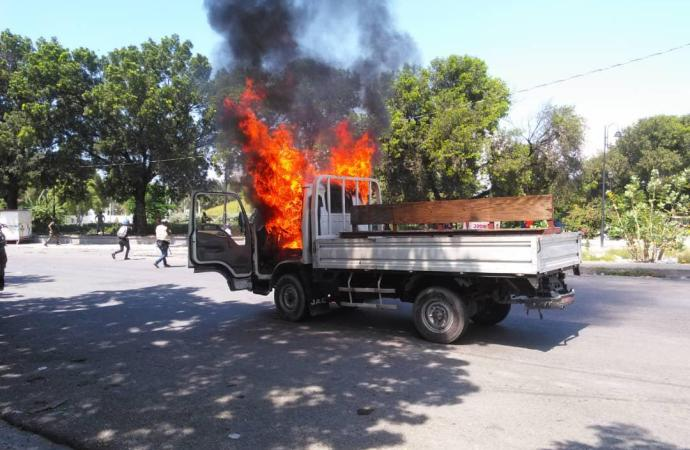 Champ-de-mars-Affrontement entre des agents de l'USGPN et des militants politiques:  Un véhicule incendié, une personne blessée