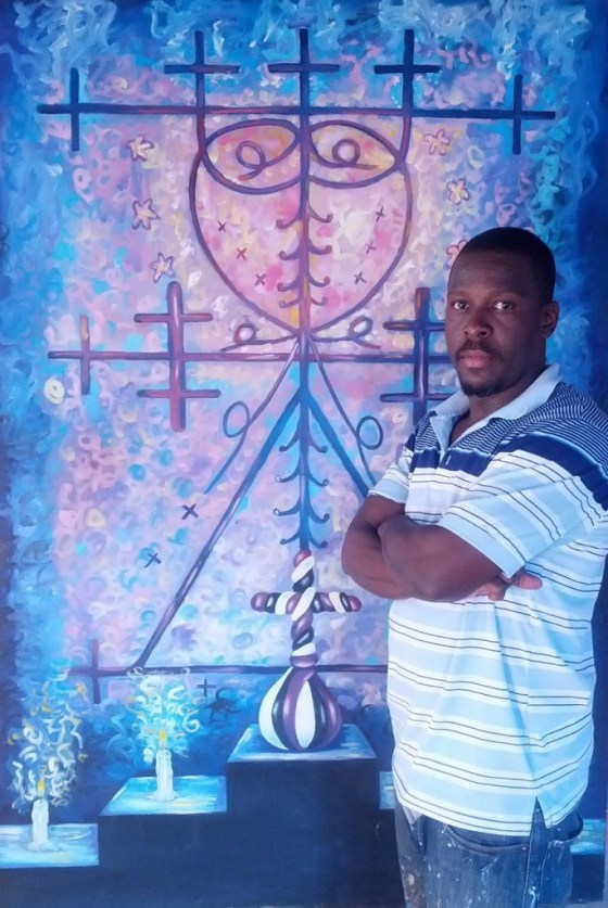 """Florestal Evens and his painting """"Haitian Symbol"""""""