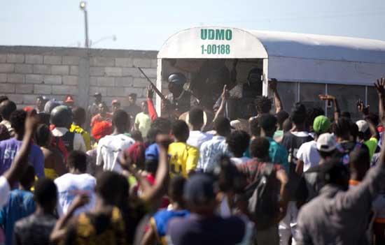 Witnesses: Men in police garb massacred civilians in Haiti