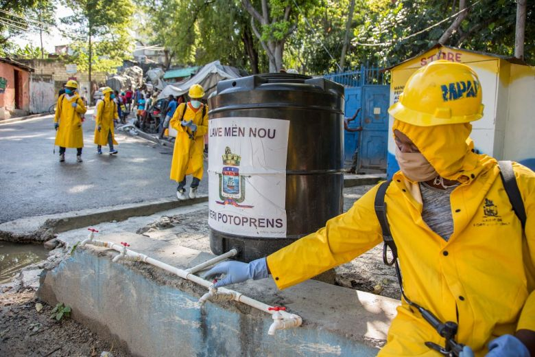 disinfecting the streets in port-au-prnce