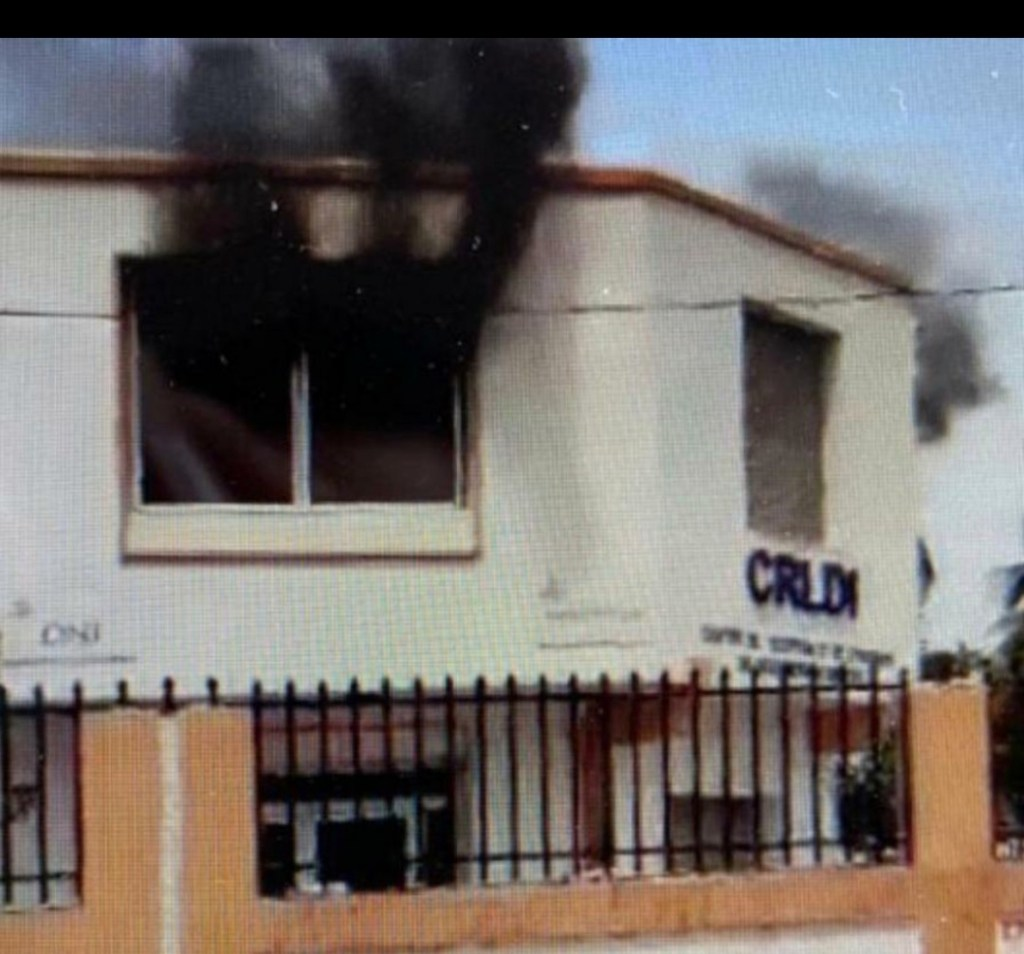 Alleged police group shoot, set buildings on fire to free former cop