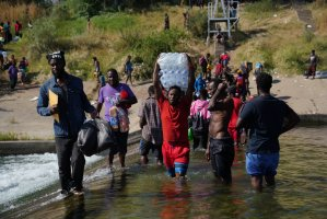 Saddened by rise in refugees and migrants, Haitian-Americans denounce returns to Haiti