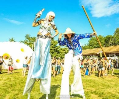 Sparkly silver cyborg on stilts and karate guy stilt-walker kitchener ever after festival 2016