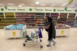 A little bit more like home … Eid greeting cards at the Tesco Extra supermarket in North London, which also carries the company's best wishes for Ramadan, and aisles packed with iftar favourites. Stephen Lock / The National