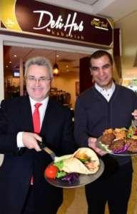 Birmingham Airport CEO Paul Kehoe (left) and Deli Hub Managing Director Sydd Sadiq salute the new opening