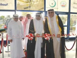 Director General of Agricultural Affairs of the Makkah Al Mukarramah region Engineer Hassan Bin Obaid Sankouf (middle) cuts the ceremonial ribbon, assisted by ACE vice president for events and exhibitions Walid Wakid (right)