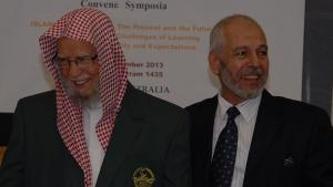 World Muslim League general secretary Abdallah Ben Abdel Mohsen Al-Turki wearing the school blazer of Sydney's Malek Fahd Islamic School, with AFIC president Hafez Kassem. Source: News Corp Australia