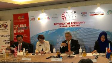 Minister of the International Trade and Industry Dato' Sri Mustapa Mohamed (second from the right) speaks at the press conference held at KLCC.