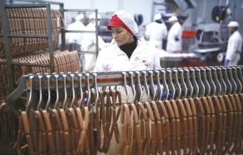 Workers at the sausages production section in Akova Impex Meat Industry Ovako, which makes halal quality certified products, in Sarajevo, Bosnia and Herzegovina