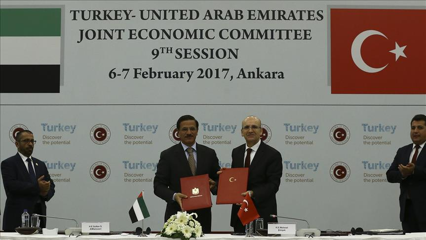 Turkish Deputy Prime Minister Mehmet Simsek (2nd R) and Sultan bin Saeed Al Mansouri (3rd L), Minister of Economy of UAE pose for a photo following signing a memorandum of understanding during the 9th Turkish-UAE Joint Economic Committee (JEC) Meeting, in Ankara, Turkey on February 07, 2017. ( Gökhan Balc? - Anadolu Agency )
