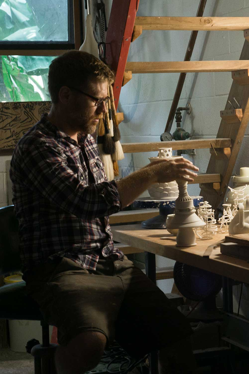 Shawn Spangler in studio working with clay
