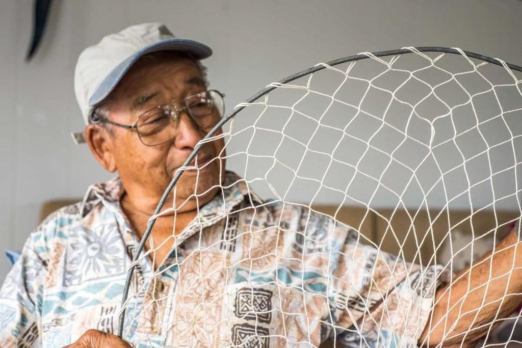 John Yu holding a net he handmade