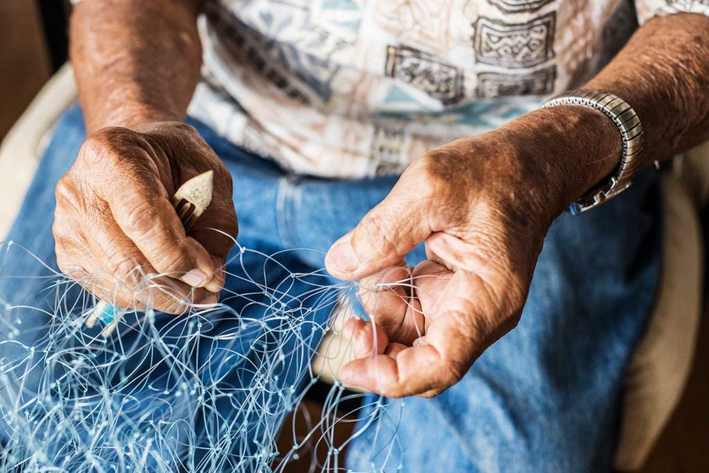 closeup of John Yu's hands holding his handmade net