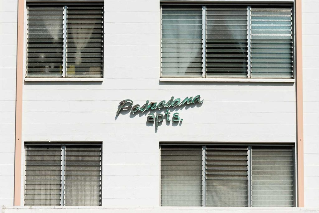 Lettering on the Poinciana Apartment building