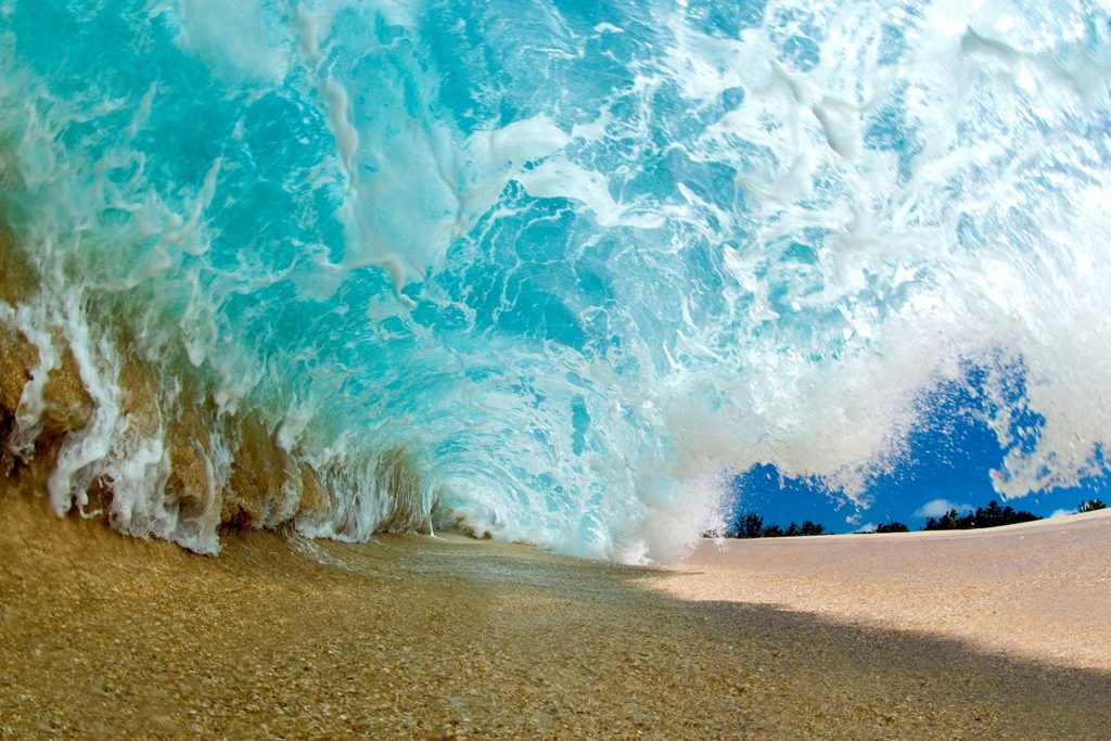 wave crashing into shoreline