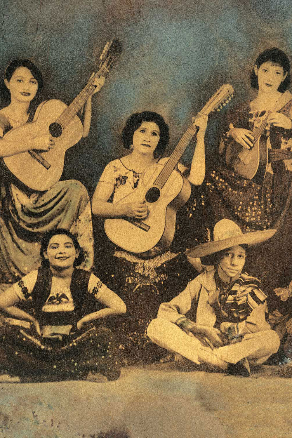 4 women and 1 male in a faded photograph, 3 holding guitars