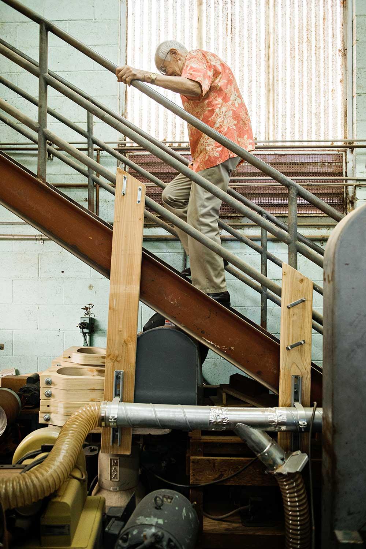 Fred Kamaka ascending stairway in ukulele factory