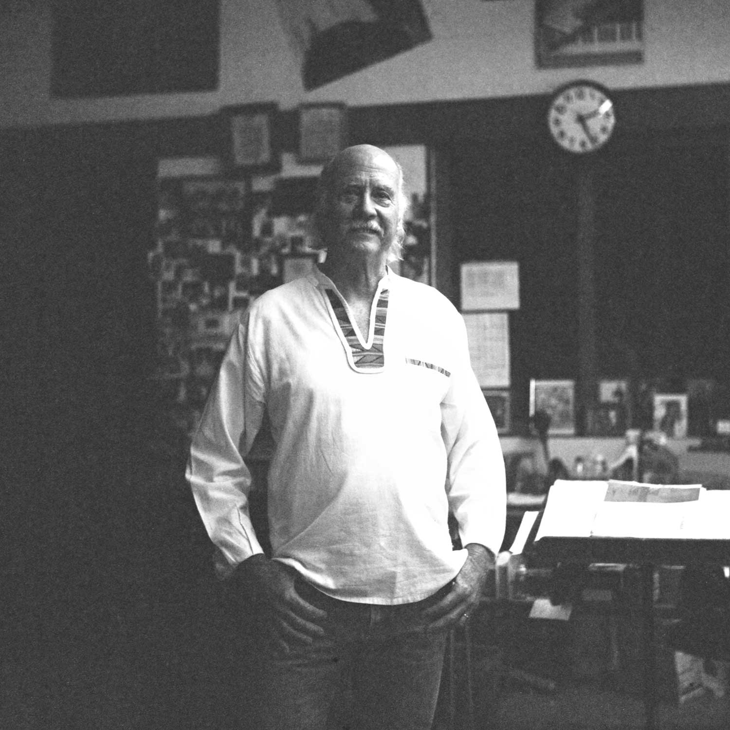 black and white photo of Gary Washburn in his workspace