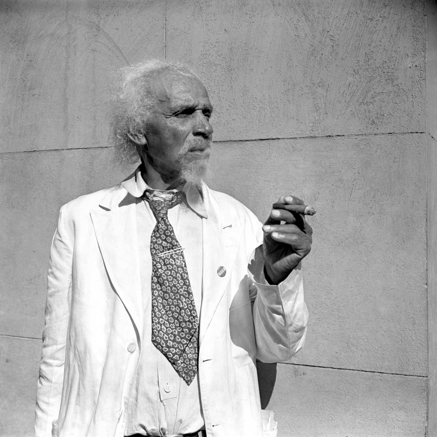 Black and white photo of man holding a cigar