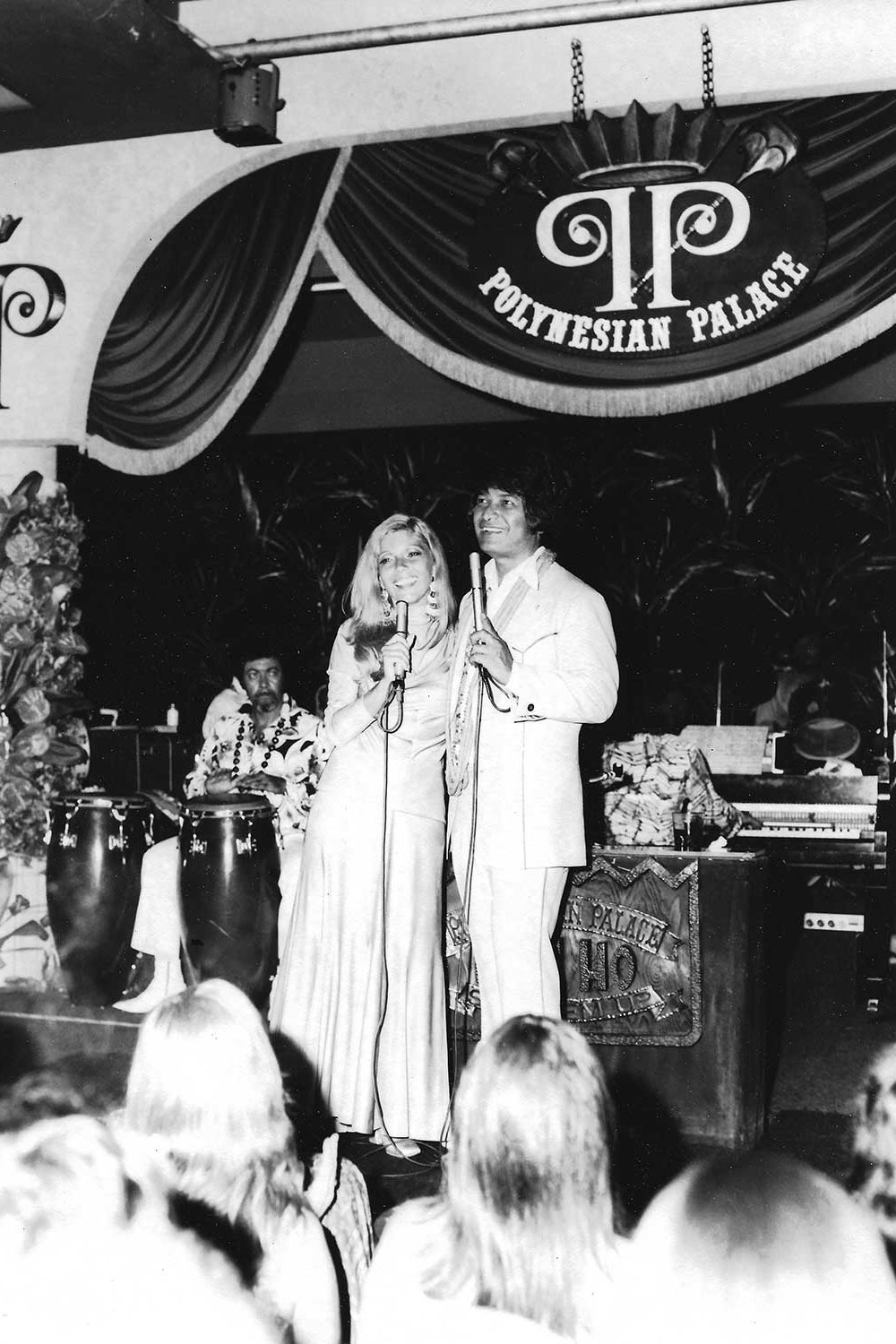 Black and white photo of Don Ho and Nancy Sinatra on stage