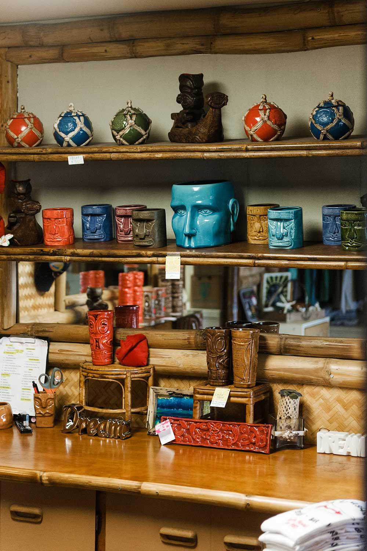 Colorful Tiki mugs on a shelf