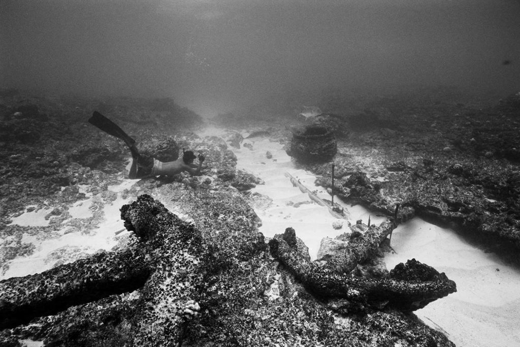 black and white photo of Randy Kosaki snorkeling underwater in ocean