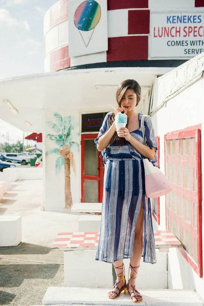 Woman in blue striped dress eating shave ice