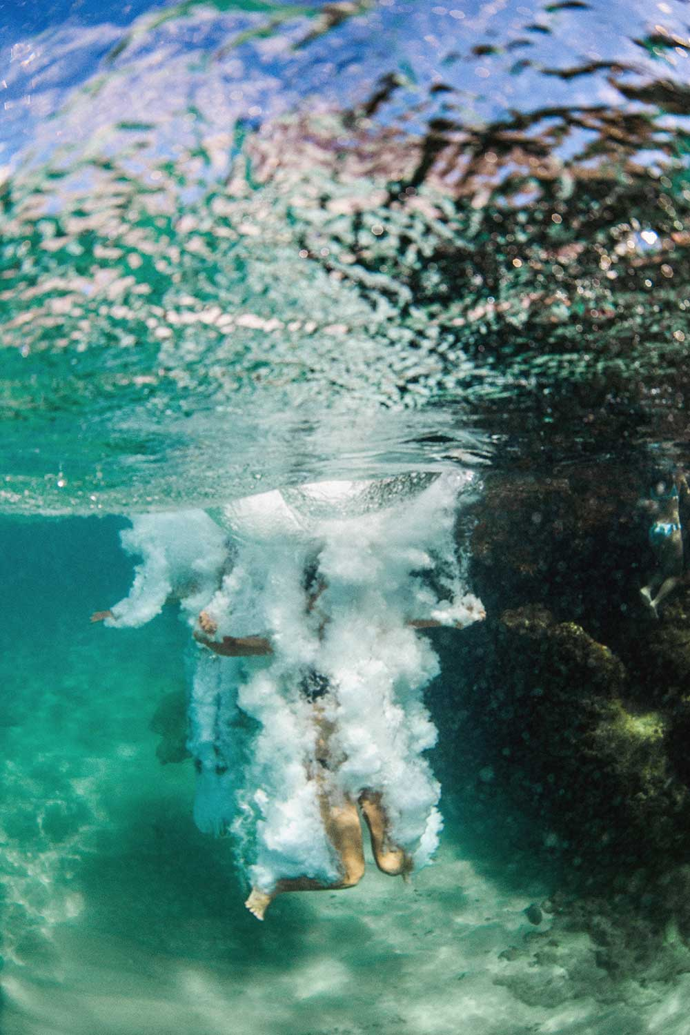 underwater photo of person who just jumped into ocean