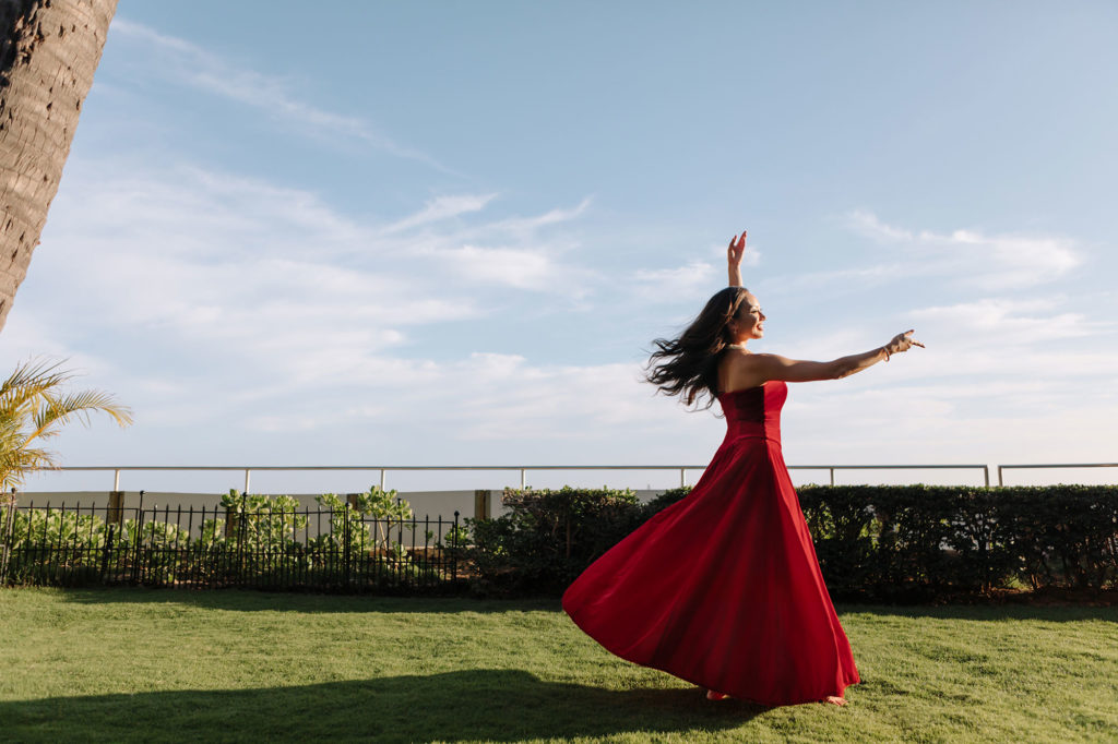 Heart of Hula dancer dressed in red