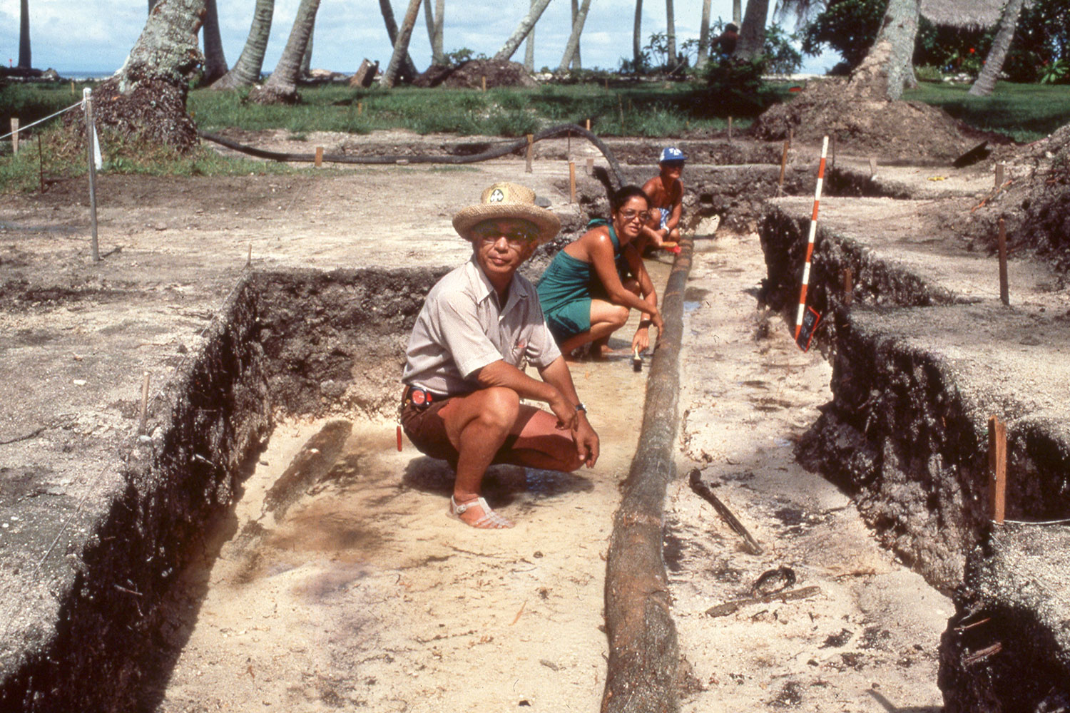 Aged color photo of people at an excavation site.