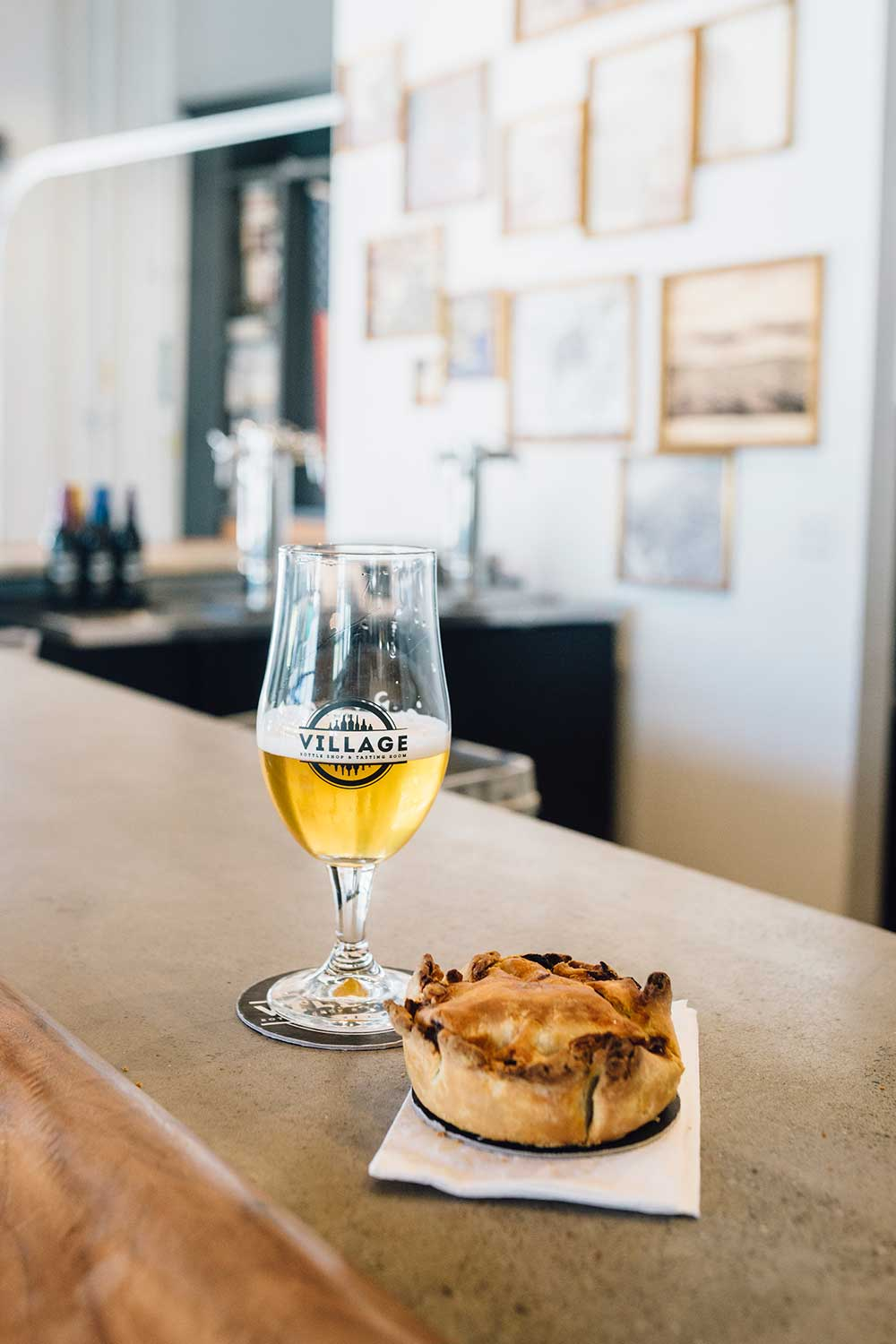 Pair your pint with house made savory pot pies at Village Bottle Shop and Tasting Room in Kaka'ako.