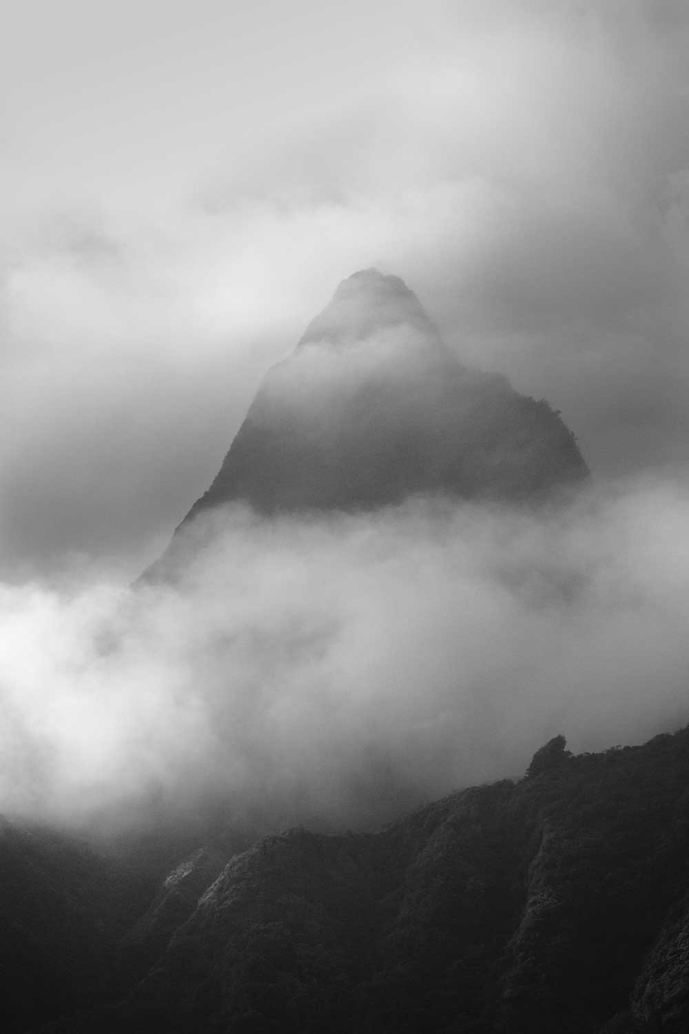 Black and white image of a single peak amongst the Koolau mountain range