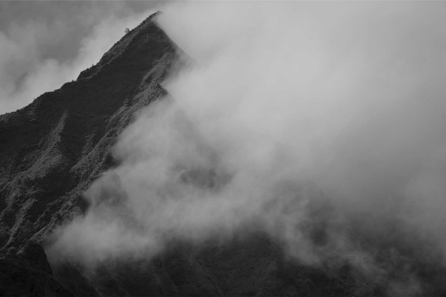 Half of a Koolau mountain peak covered with mist