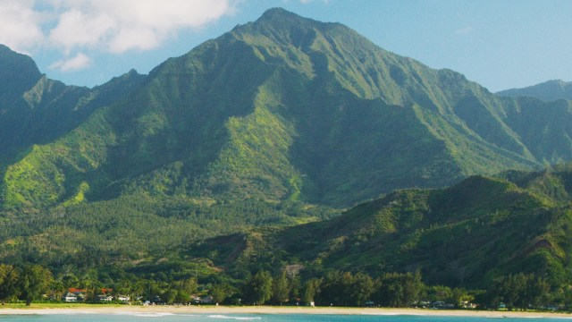 Mamalahoa mountain rising over Hanalei Bay, etched by waterfalls.