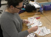 Ciara Diana, a Graphic Design student sorts through a stack of coupons during her free time from class. PHOTO BY HALEY SEDGWICK