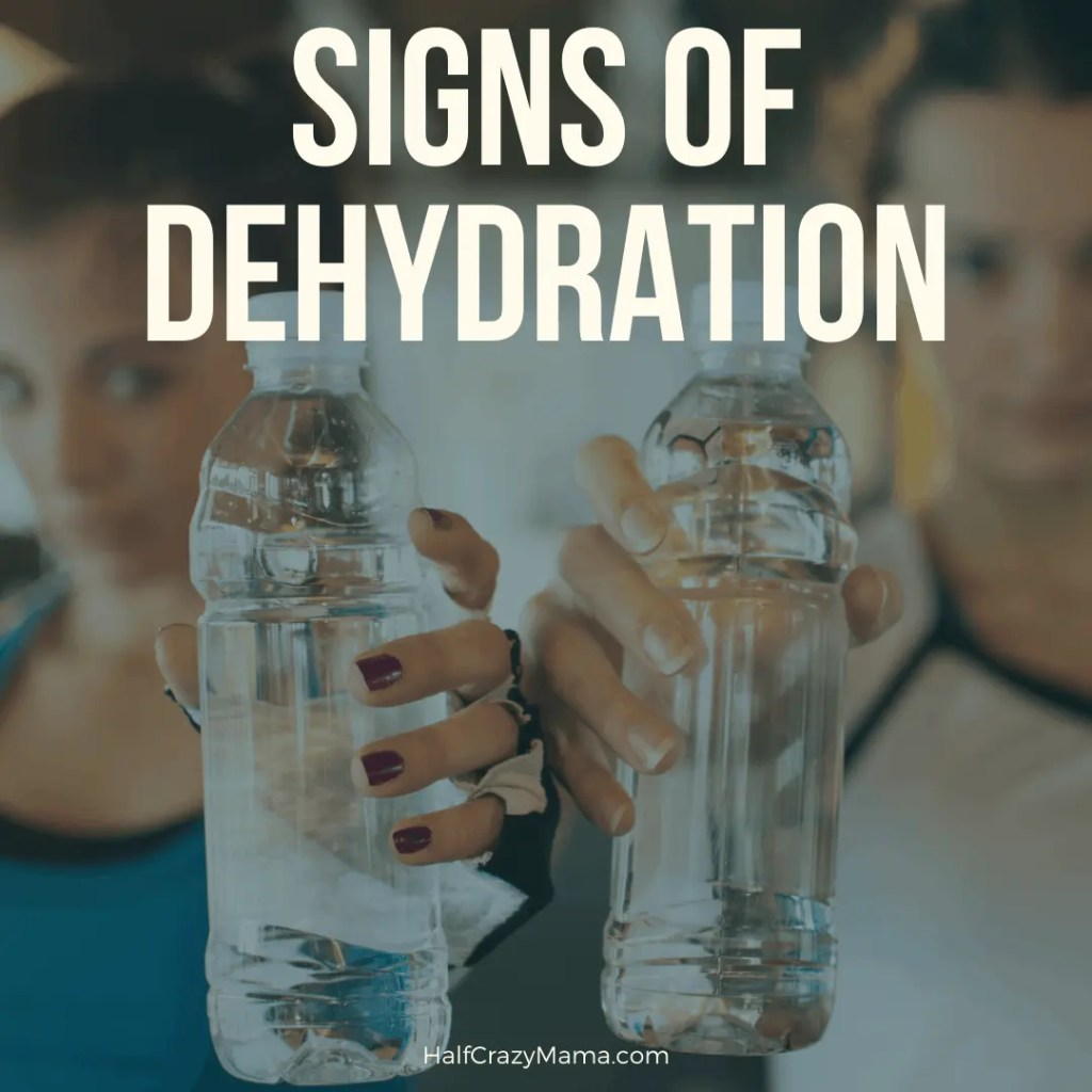 signs of dehydration women holding water bottles