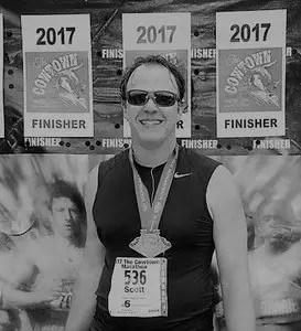 Scott completing his cowtown marathon in 2017