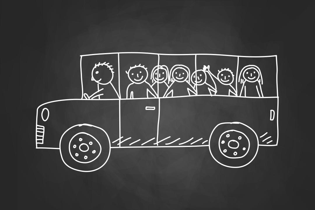 Drawing of school bus on blackboard