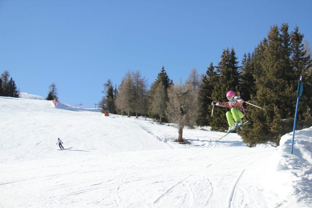 Anna jumping on skis