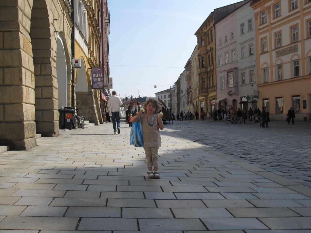 Anna on cobblestone streets holding two icecreams