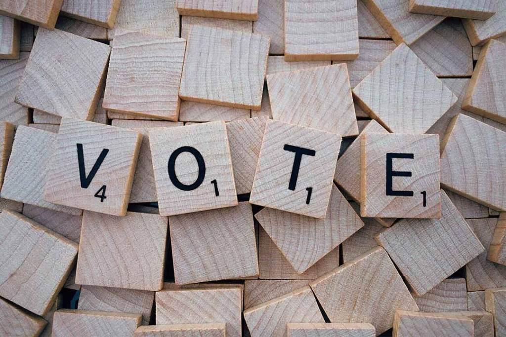 scrabble letters spell vote