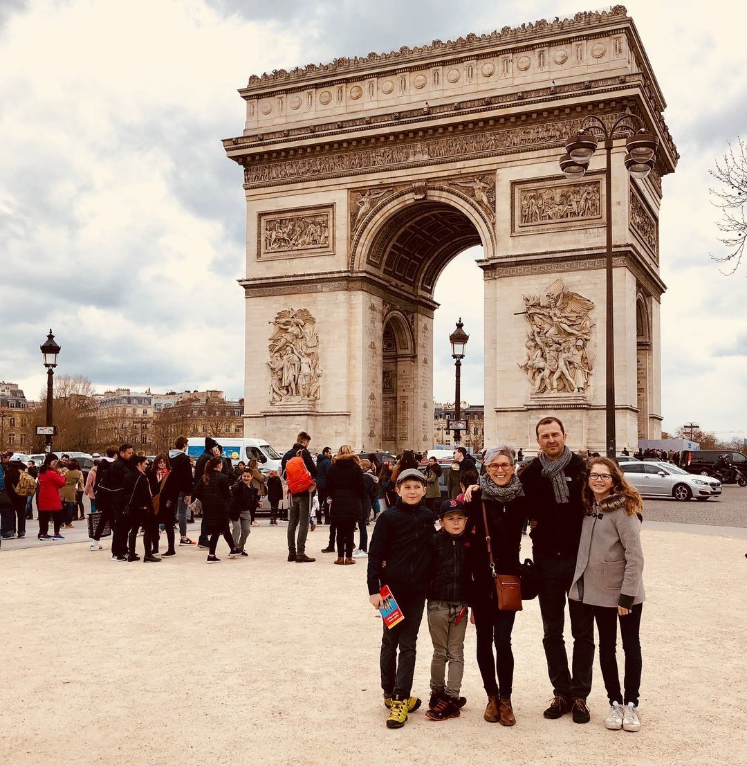 Prucha family standing in front of Arc de Triomph