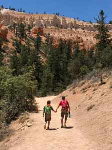 Two boys walking hand in hand in Bryce Canyon