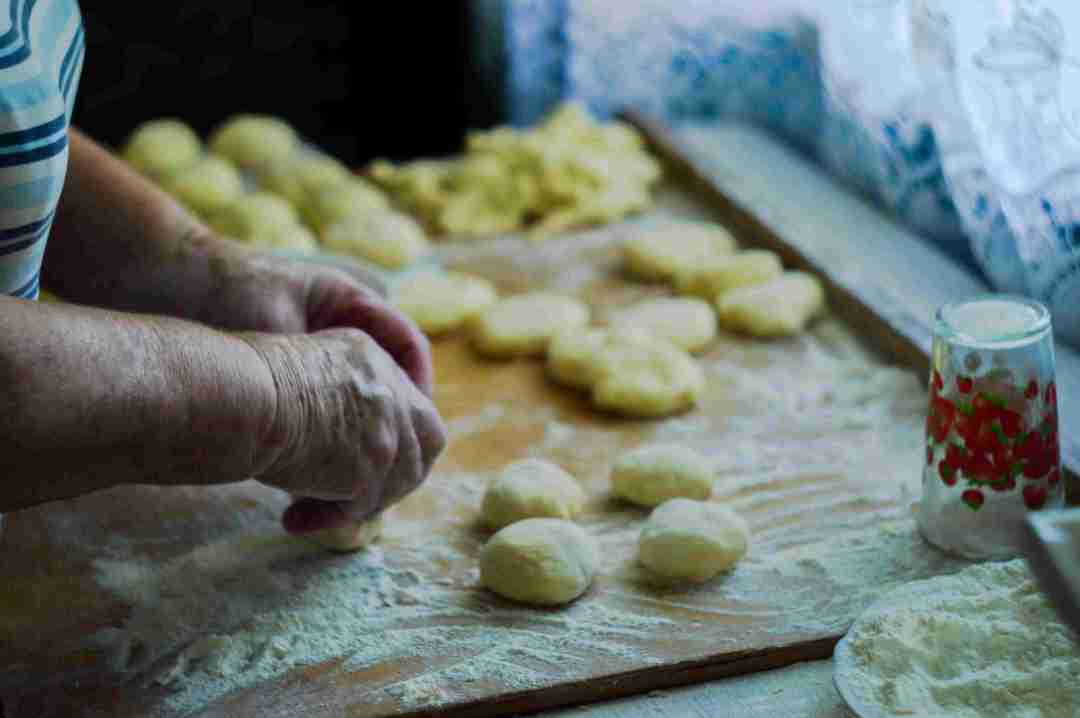 grandmother's hands making dumplings